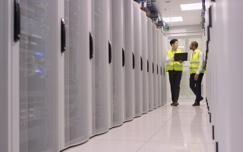 Two of Datum's staff walking through the data centre