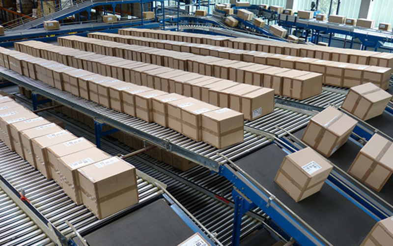 Several conveyer belts moving packages in a logistics centre