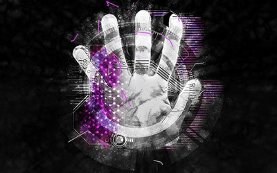 A futuristic stylised composite of a hand reaching in to a digital space representing a cyber security threat