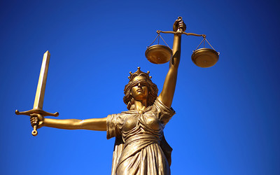 A statue of a lady holding a sword and the scales of justice