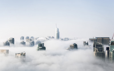 A cityscape engulfed in mist