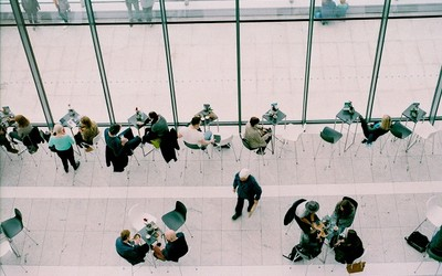 An aerial view of people enjoying coffee meetings in a cafeteria