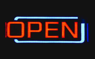 A neon sign which reads: 'open'