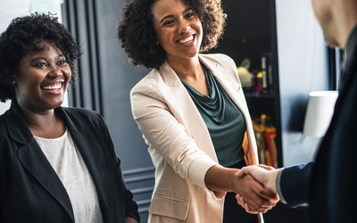 Image of business women shaking hands