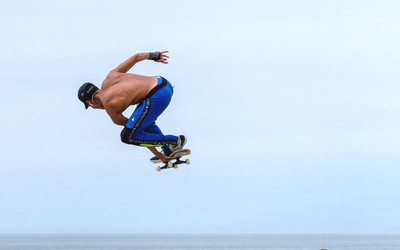 Skateboarder flying high